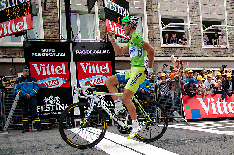 Stage winner, Slovakia's Peter Sagan celebrates on the finish line at the end of the 197 km and third stage of the 2012 Tour de France cycling race starting in Orchies and finishing in Boulogne-sur-Mer, northern France, on July 3, 2012.  The 99th Tour de France, to be held from June 30 till July 22, is made up of one prologue and 20 stages and will cover a total distance of 3.497 kilometres.   AFP PHOTO / NATHALIE MAGNIEZ        (Photo credit should read NATHALIE MAGNIEZ/AFP/GettyImages)